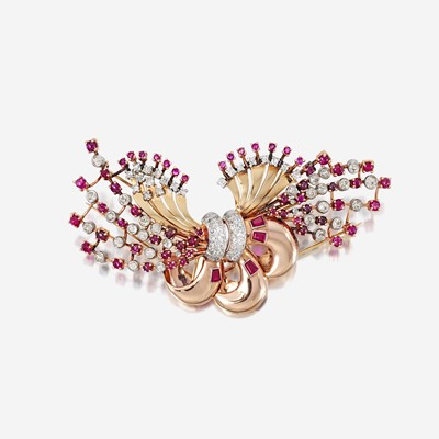 Lot 20 - A Retro fourteen karat bicolor gold, diamond, and ruby clip/brooch