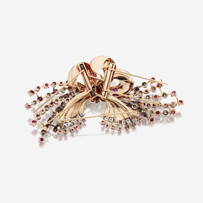Lot 20 - A Retro fourteen karat bicolor gold, diamond, and ruby clip/brooch