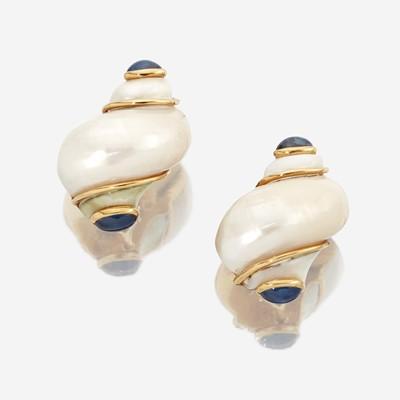 Lot 30 - A pair of turbo shell, sapphire, and eighteen karat gold earclips, Seaman Schepps
