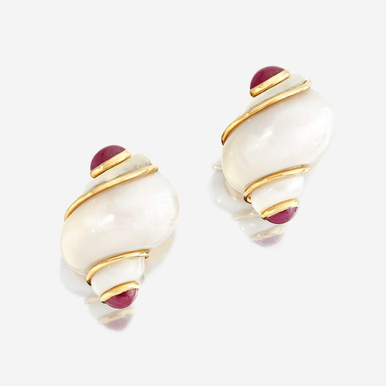 Lot 32 - A pair of turbo shell, ruby, and eighteen karat gold ear clips, Seaman Schepps