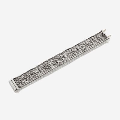 Lot 6 - An Art Deco diamond and platinum strap bracelet