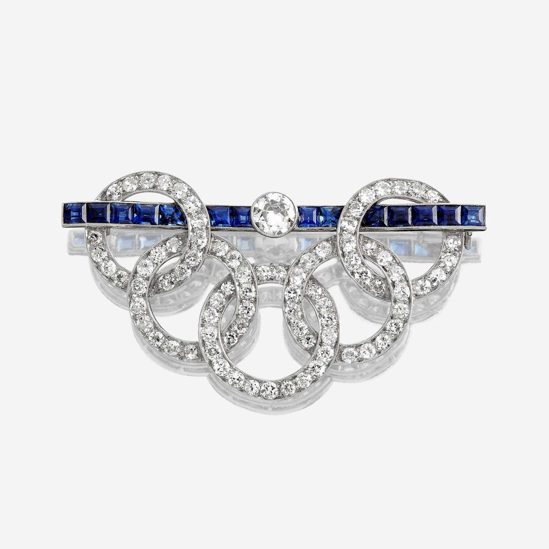 Lot 14 - A diamond and sapphire brooch