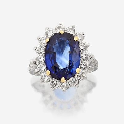 Lot 11 - A sapphire, diamond, and platinum ring