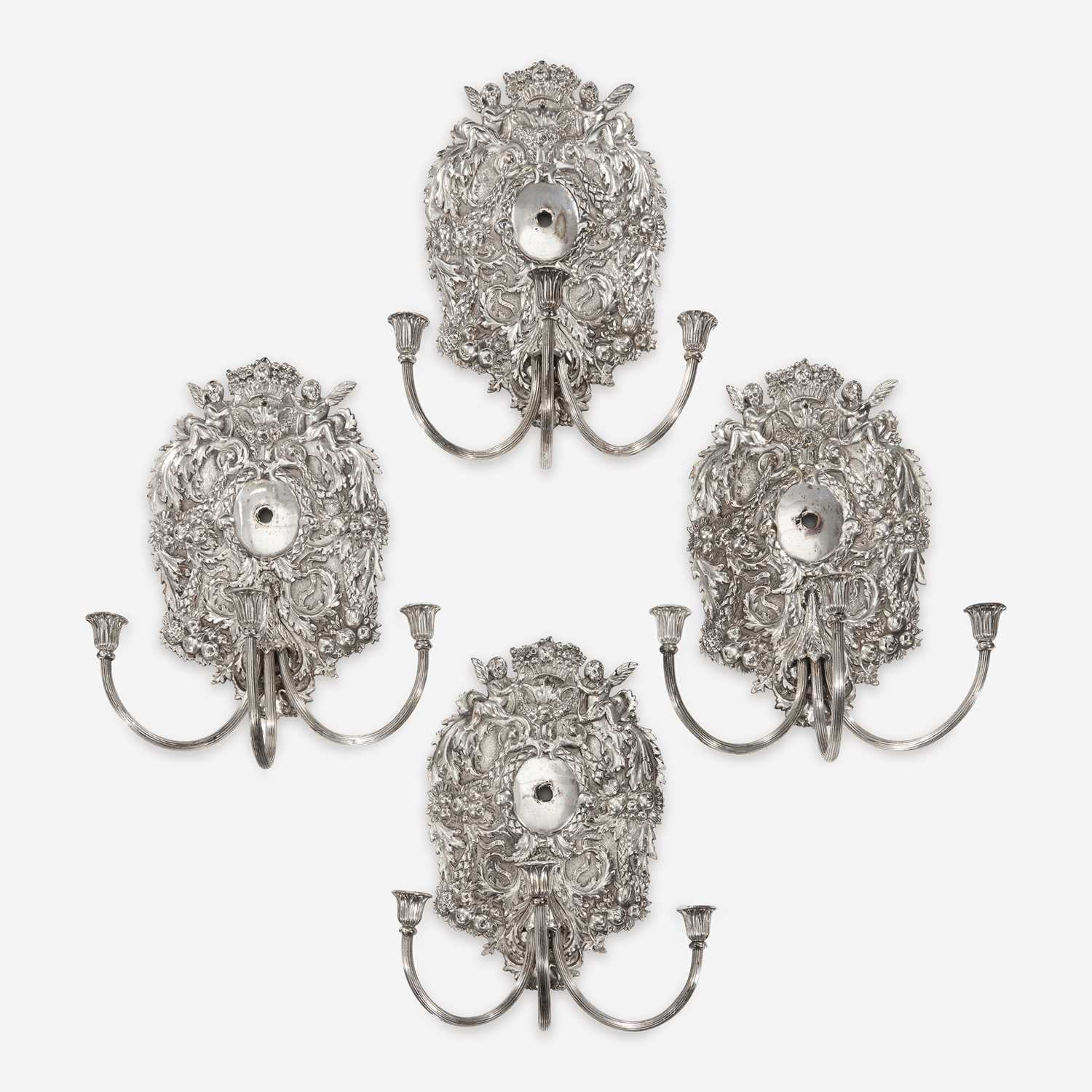Lot 13 - A set of four William & Mary style silverplated wall lights