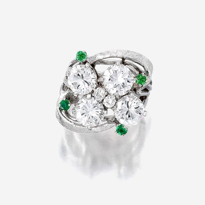 Lot 95 - A diamond, green stone, and fourteen karat white gold ring