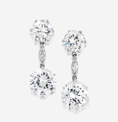 Lot 92 - A pair of diamond and eighteen karat white gold earrings