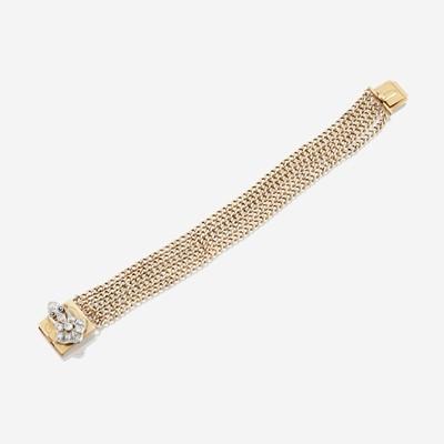 Lot 20 - A fourteen karat gold, platinum, and diamond bracelet