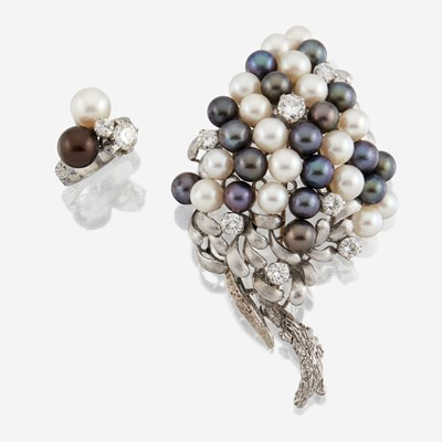 Lot 177 - A cultured pearl, diamond, and fourteen karat white gold brooch with similar ring