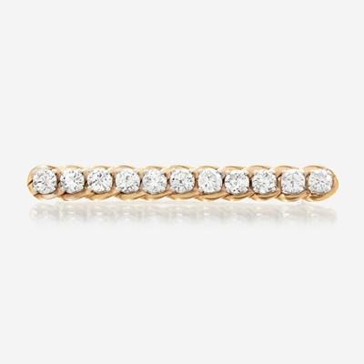 Lot 31 - A diamond and fourteen karat gold pin