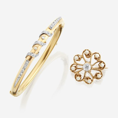 Lot 131 - A fourteen karat gold and gem-set bangle and pendant/brooch