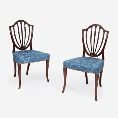 Lot 145 - A pair of George III shield-back mahogany side chairs