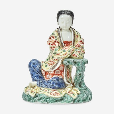 Lot 9 - A Chinese enameled Dehua porcelain figure of Guanyin seated