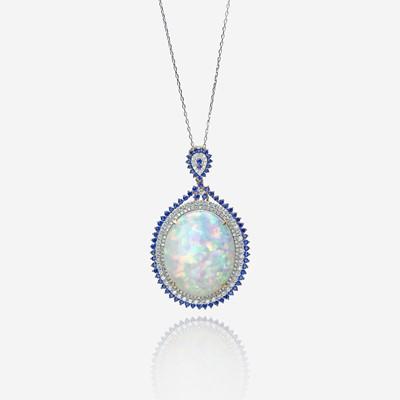 Lot 110 - An opal, diamond, sapphire, and fourteen karat gold pendant with chain