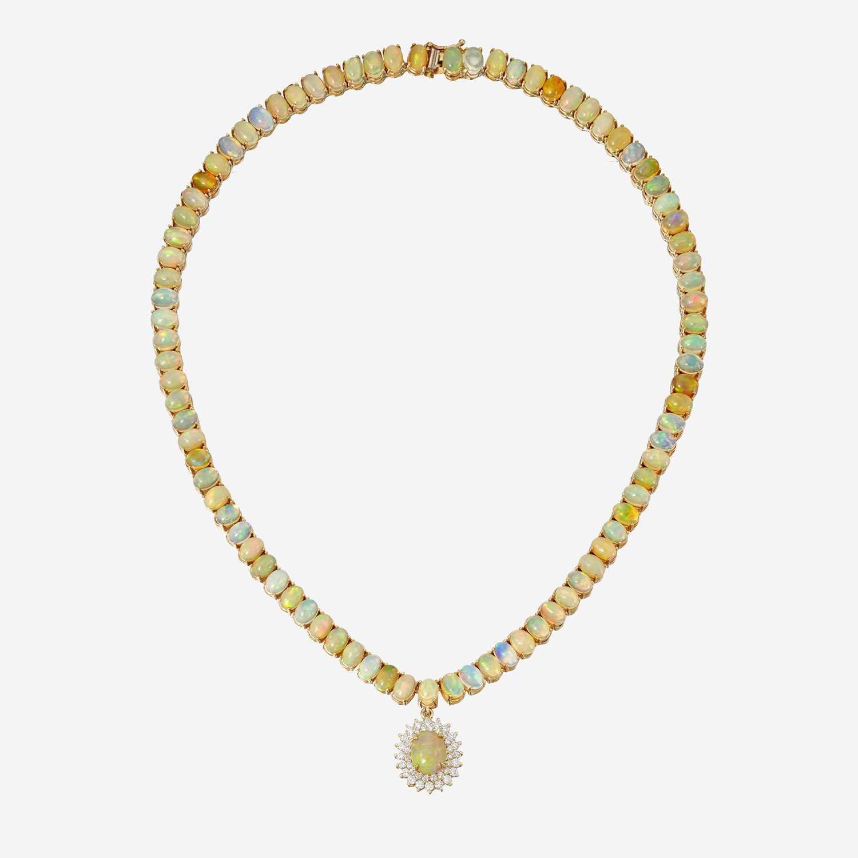 Lot 70 - An opal, diamond, and fourteen karat gold necklace