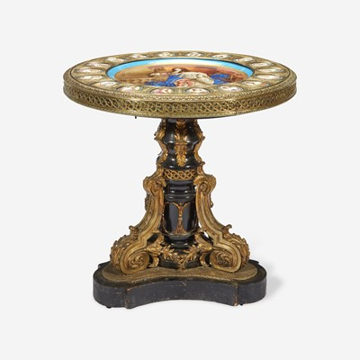 Lot 53 - A Sèvres Style Porcelain Mounted Ebonized and Gilt-Bronze Gueridon Table