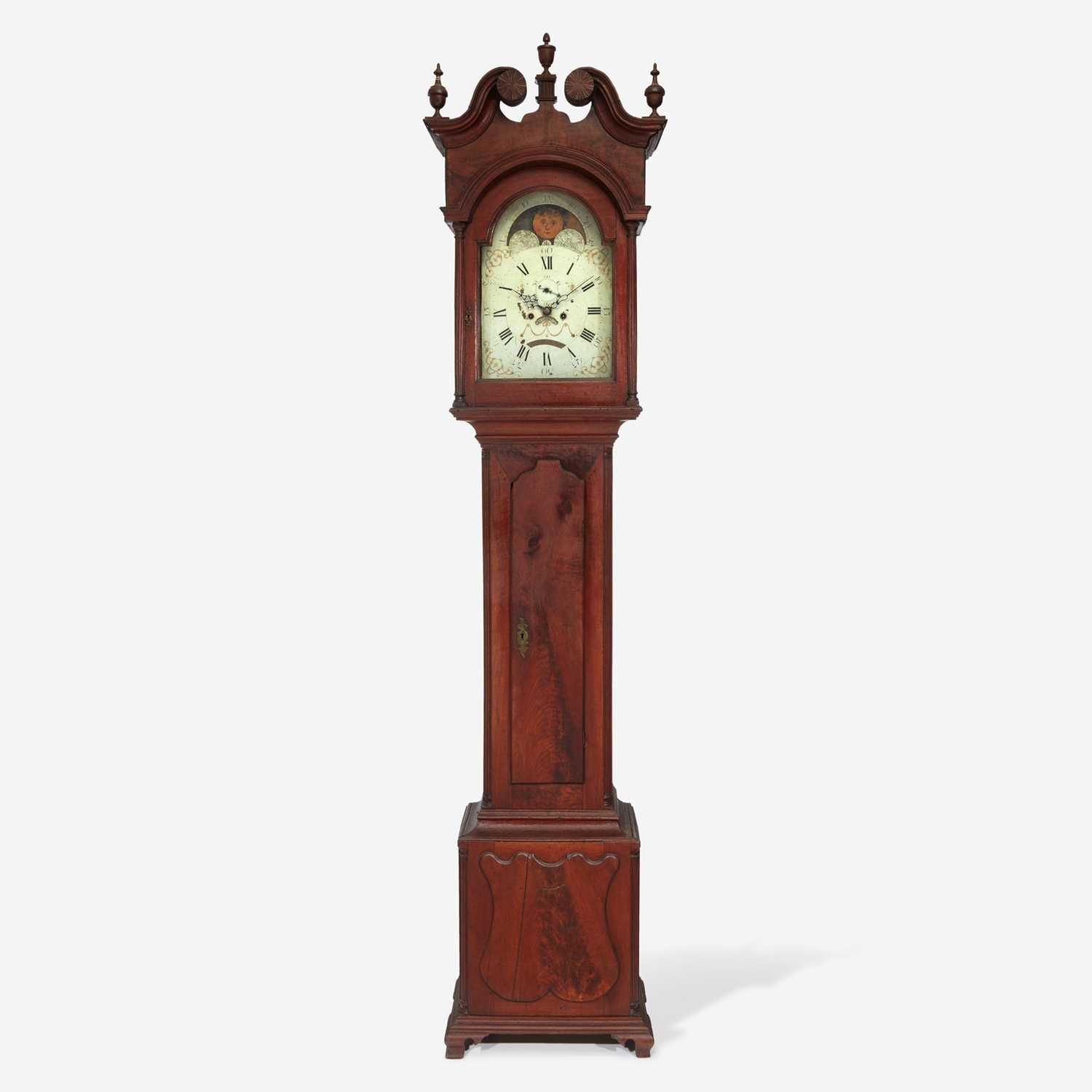 Lot 70 - A Chippendale carved walnut tall case clock