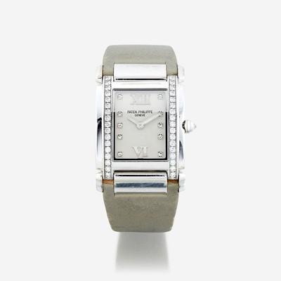 Lot 126 - A lady's eighteen karat white gold and diamond, strap wristwatch, Patek Philippe