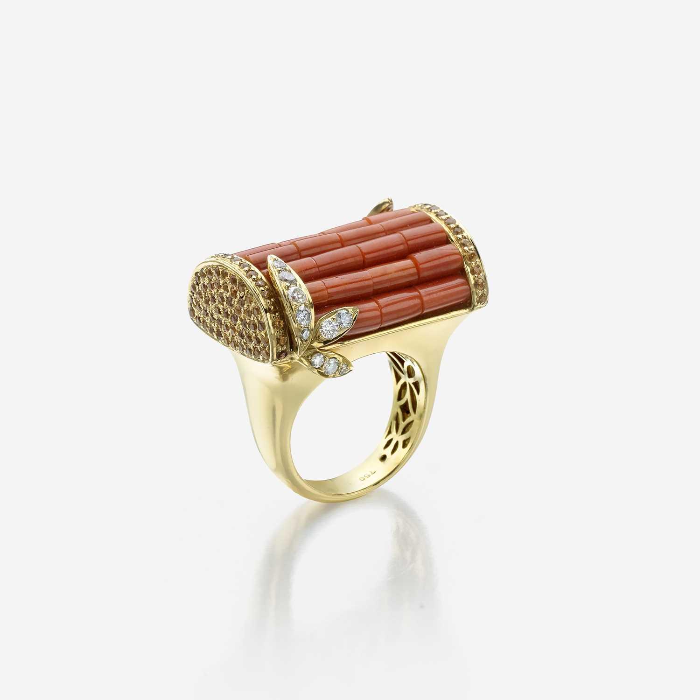 Lot 60 - A coral, diamond, yellow sapphire, and eighteen karat gold ring