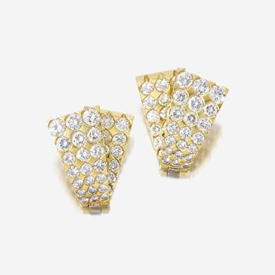 Lot 79 - A pair of diamond and eighteen karat gold earrings