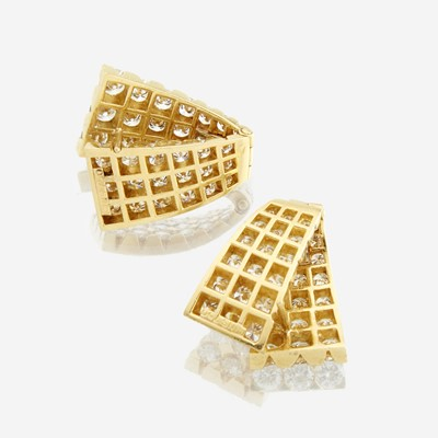 Lot 79 - A pair of diamond and eighteen karat gold earrings