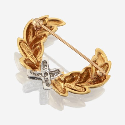 Lot 34 - A pair of eighteen karat gold, platinum, and diamond brooches, Tiffany & Co.