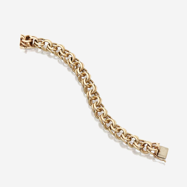 Lot 89 - A fourteen karat gold bracelet