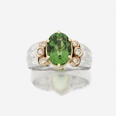 Lot 116 - A tsavorite garnet, diamond, and fourteen karat gold ring