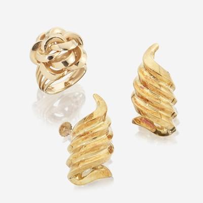 Lot 135 - A pair of eighteen karat gold ear clips and a fourteen karat gold ring