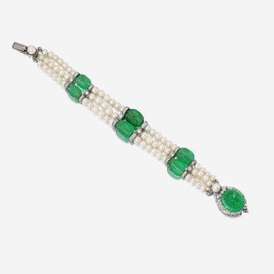 Lot 137 - An Art Deco carved emerald, pearl, and diamond bracelet