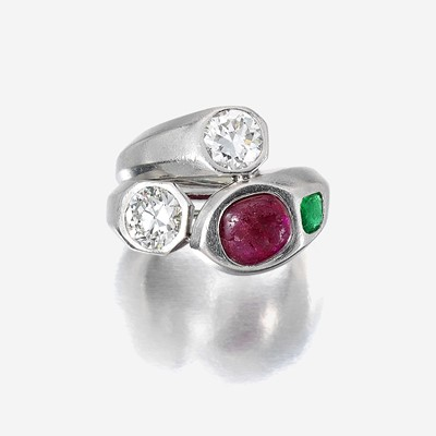 Lot 100 - A diamond, ruby, emerald, and platinum ring