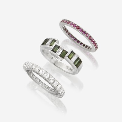 Lot 174 - A collection of three platinum and gem-set bands