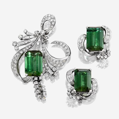 Lot 133 - A pair of green tourmaline, diamond, and platinum ear clips and brooch