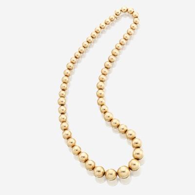 Lot 27 - A fourteen karat gold necklace, Tiffany & Co.