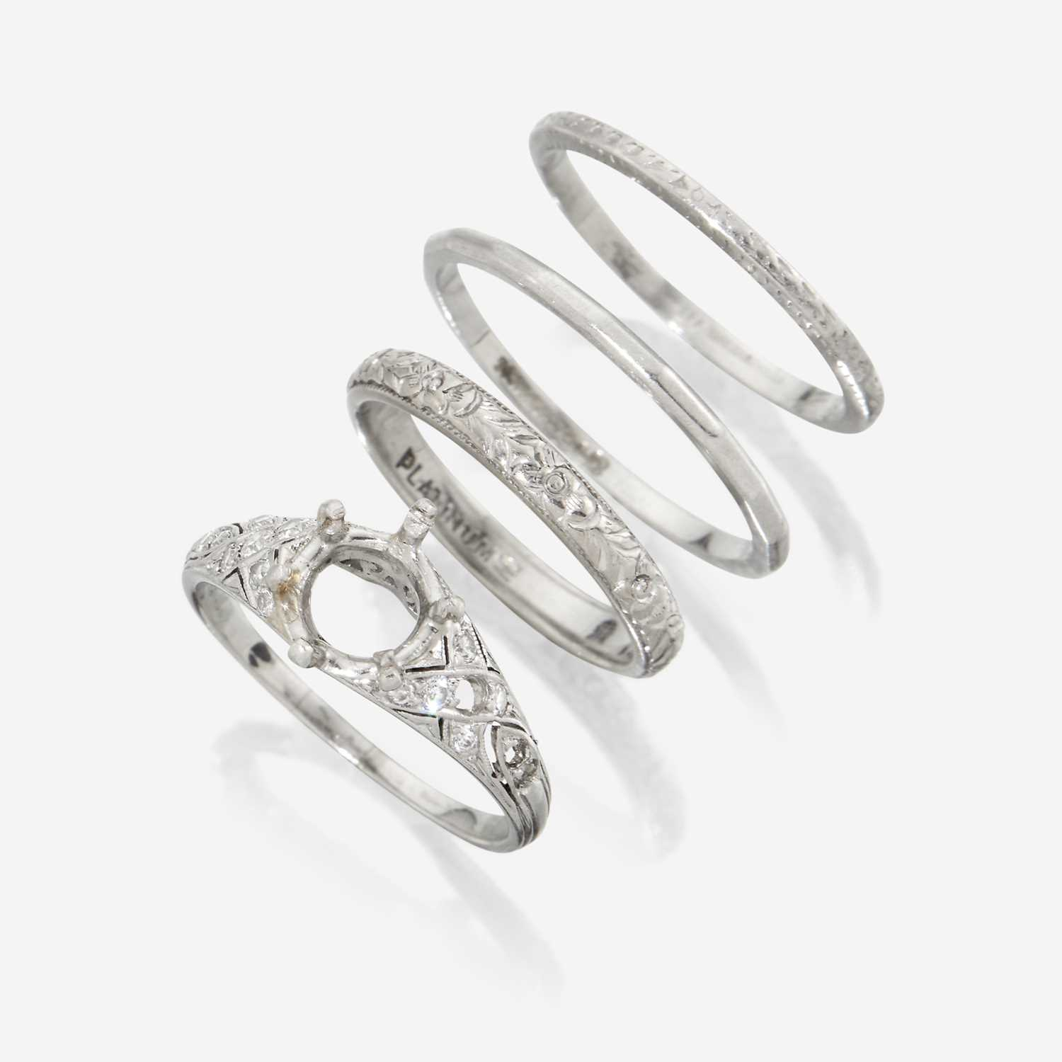 Lot 78 - A collection of four platinum rings