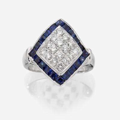 Lot 71 - An eighteen karat white gold, diamond, and sapphire ring