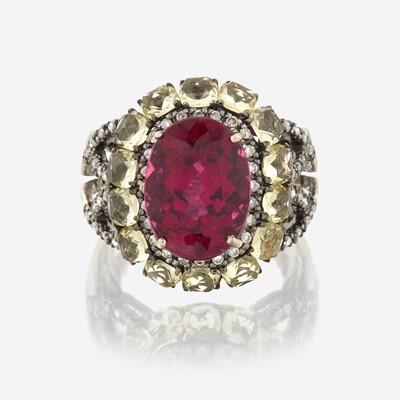 Lot 160 - A pink tourmaline, peridot, diamond, and eighteen karat gold ring