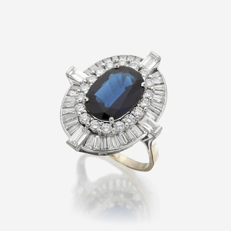 Lot 63 - A sapphire, diamond, and eighteen karat white gold ring