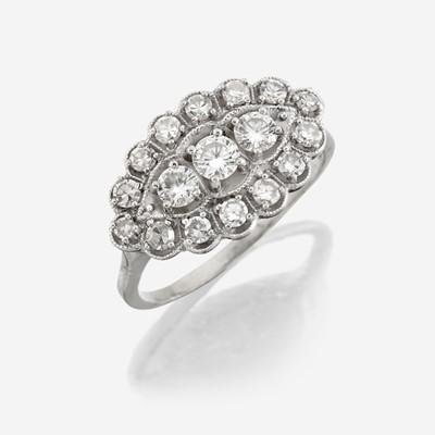 Lot 14 - A diamond and fourteen karat white gold ring