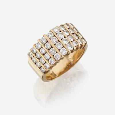 Lot 139 - A diamond and fourteen karat gold wide band