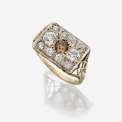 Lot 105 - A colored diamond, diamond, and fourteen karat white gold ring