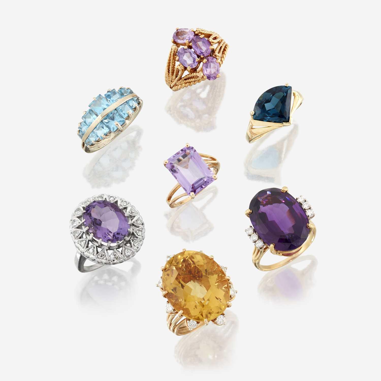 Lot 81 - A collection of seven fourteen karat gold and gem-set rings