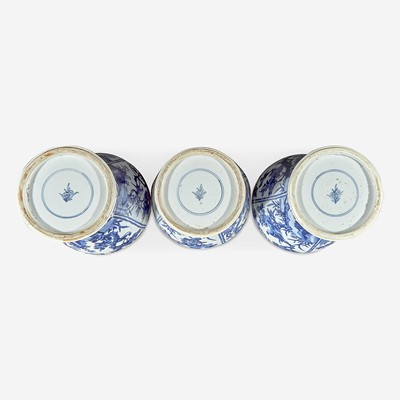 Lot 36 - Three Chinese blue and white porcelain baluster vases and covers