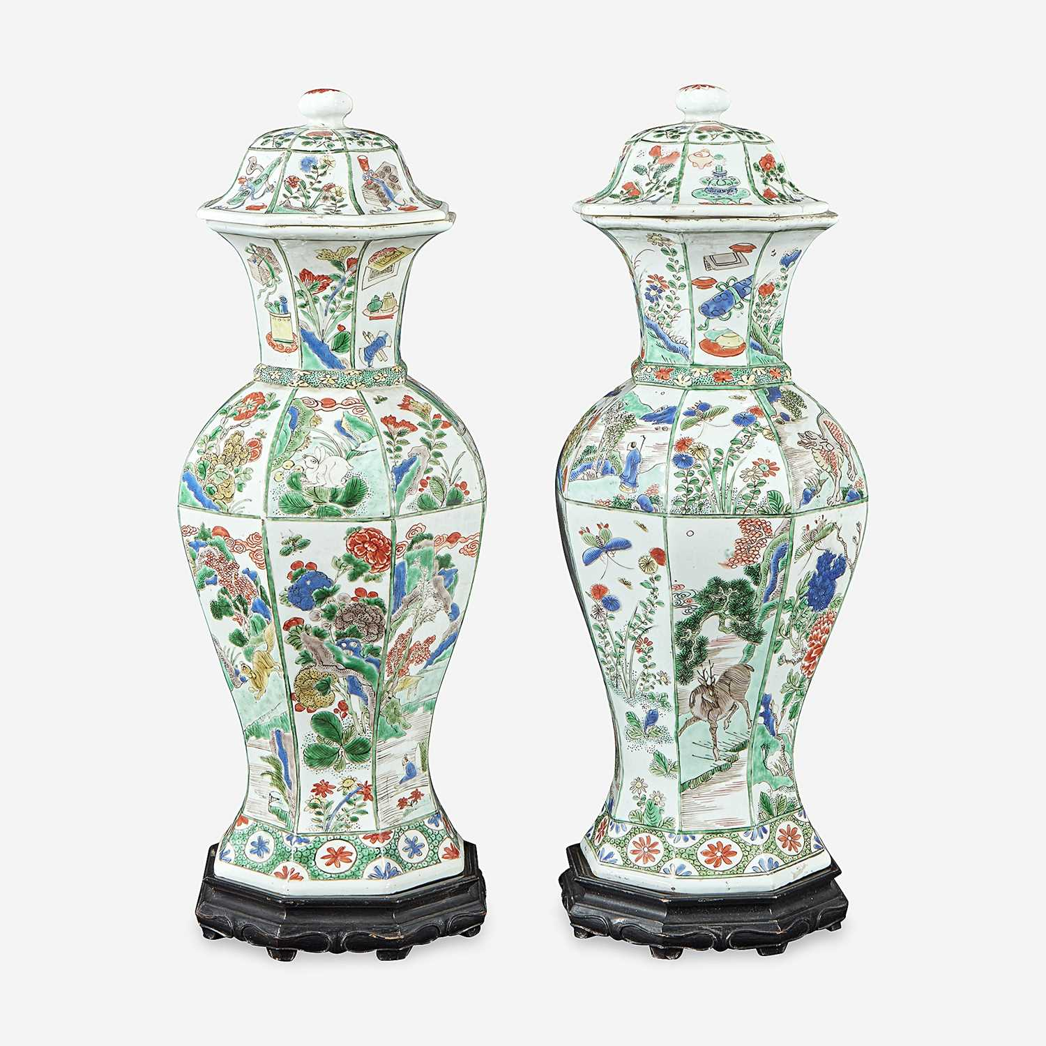 Lot 42 - A pair of Chinese famille verte-decorated octagonal baluster vases and covers