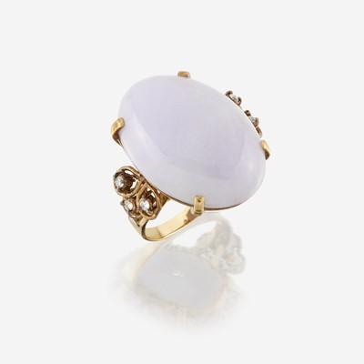 Lot 150 - A lavender jade, diamond, and fourteen karat gold ring