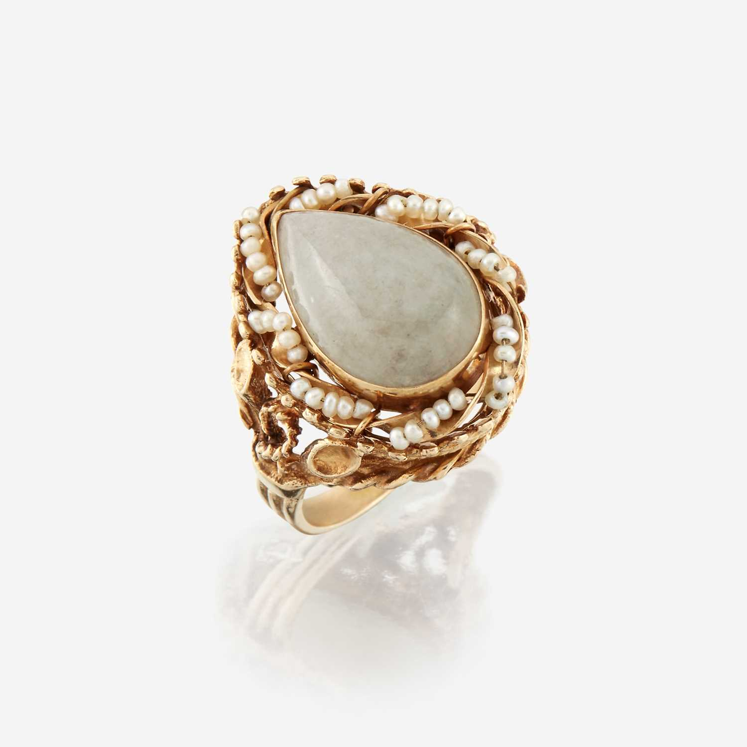 Lot 23 - A jade, seed pearl, and fourteen karat gold ring
