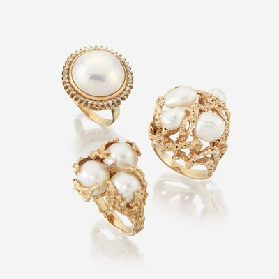 Lot 126 - A collection of three pearl and fourteen karat gold rings