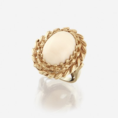 Lot 149 - A coral and fourteen karat gold ring