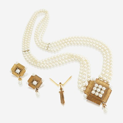 Lot 119 - A cultured pearl, eighteen karat gold, and diamond necklace with matching earrings