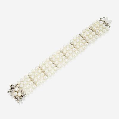 Lot 176 - A cultured pearl, diamond, and fourteen karat white gold bracelet
