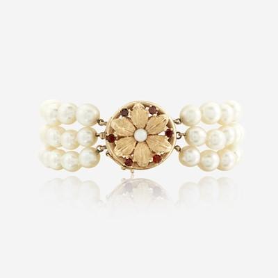 Lot 152 - A cultured pearl, fourteen karat gold, garnet, and opal bracelet